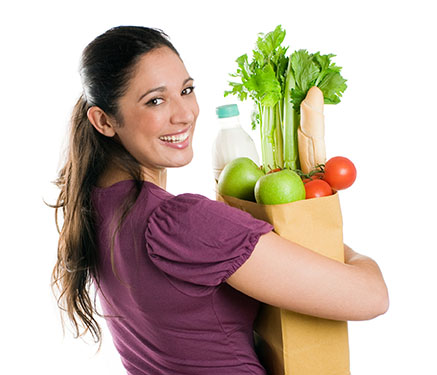 Eat These Ten Healthy Foods to Enhance Heart - women holding bag of healthy groceries