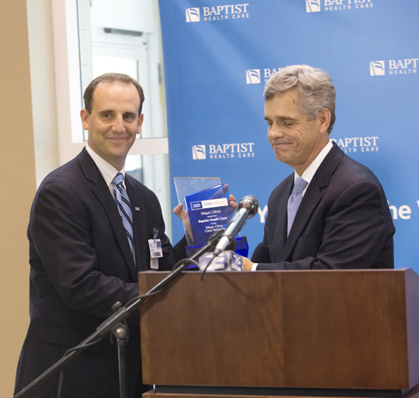 Mark Faulkner - CEO Baptist Health Care accepting Mayo Clinic Care Network plaque from Dr. Stephen Lange, Assistance Professor of Medicine at Mayo Medical School