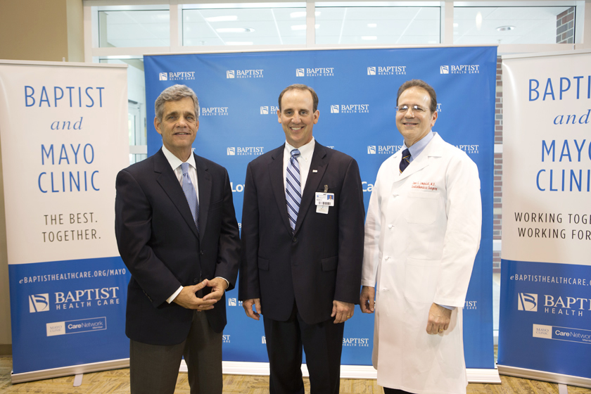 Mark Faulkner CEO-Baptist Health Care, Dr. Stephen Lange, Assistance Professor of Medicine at Mayo Medical School and Dr. James Lonquist - Cardiology posing together at Baptist and Mayo teaming together announcement. .
