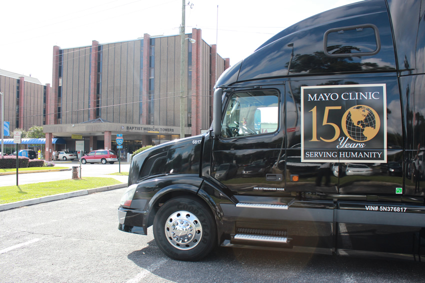 Mayo Clinic truck exhibit parked in front of Baptist Health Care Medical Towers.