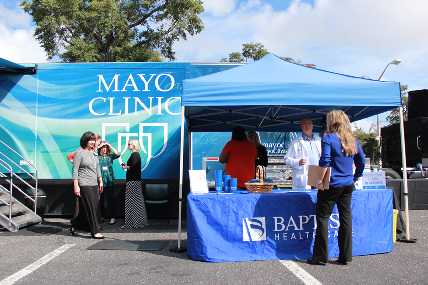 Visitors at Mayo Clinic Truck booth at Baptist Health Care Medical Towers